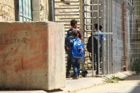 06.09.15. Hebron, Checkpoint 56. Palestinian children crossing checkpoint on their way to school. Photo EAPPI /R. Leme