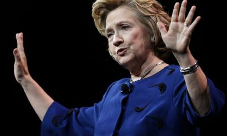 Woman throws Shoe at Hillary Clinton