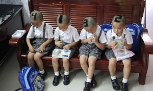 SIX-YEAR-OLD QUADRUPLETS from Shenzhen, China with their hair shaved into numbers before they start go to school for their first time. Their parents decided to mark them with 1, 2, 3, 4 on their heads to make it easier for teachers and classmates to tell them apart. (AMANPOUR. producer Claire Calzonetti says her parents painted her toenail to distinguish her from her twin!)