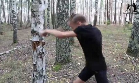 Young Girl Dismantles A tree With Her Bare Hands While She Practice Her Boxing Techniques