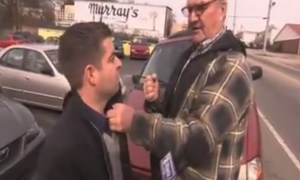 Old Man Punches News Reporter In The Mouth For Following Him In His Place Of Business Uninvited!