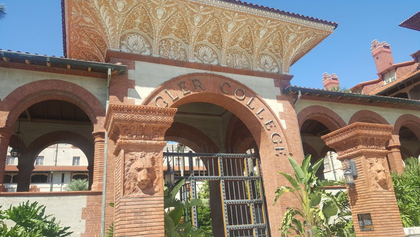 Gateway Arch of Flagler College with Palm trees