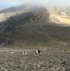 """A smaller group of us took on the challenge of summiting Mt. Ngauruhoe (Mt. Doom) part way through, but to no completion. The entire mountain is very steep scree (basically a pile of ash with a few small volcanic rocks that easily get dislodged and go tumbling down the mountain toward you or other fellow hikers). It is very accurately described as, """"one step up, two steps back."""" Unfortunately the top was covered in clouds, so we weren't able to make it all the way up."""