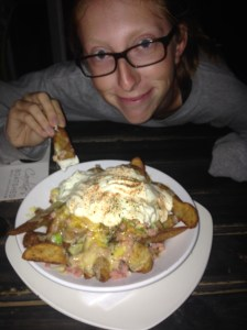 Rachel and her plate of decadent wedges at Caroline's