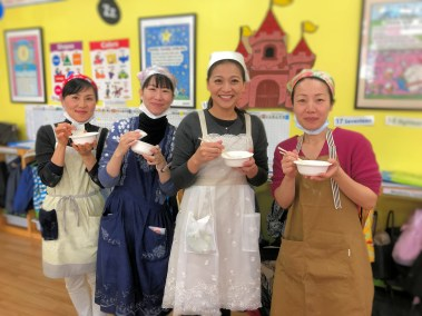 Japanese school mothers in cooking costumes