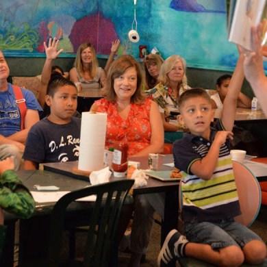 Teacher-Coordinator Autumn Bevins reads aloud to children and mentors.