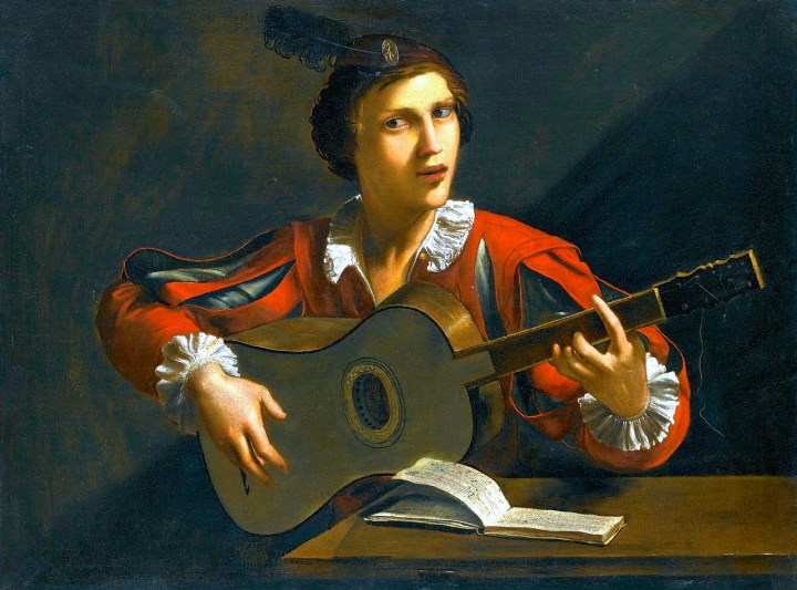 A 5 course baroque guitar and player. The painting is attributed to Italian artist Pietro Paolini, 1603–1681.
