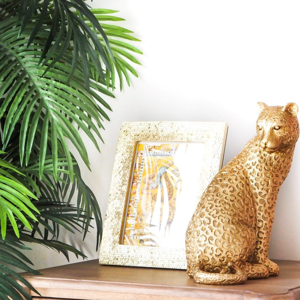 Get the 'Tropical Vibe' in your home with the Leopard Statue