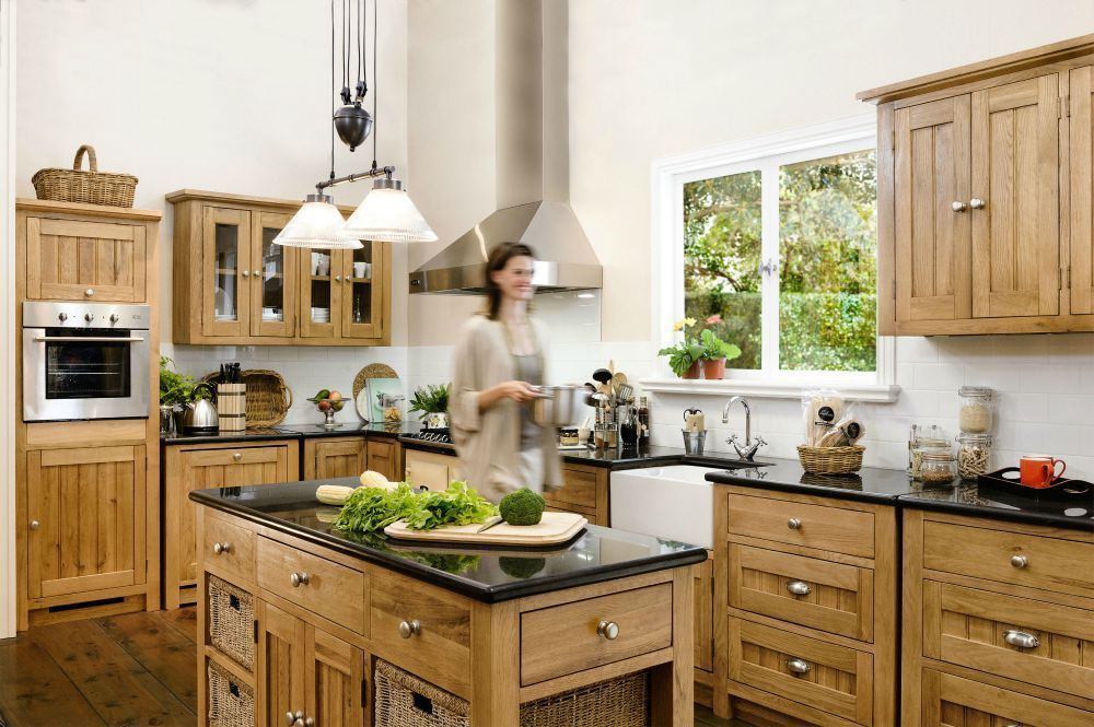 6 Simple Steps to Planning Your Dream Kitchen lady in kitchen