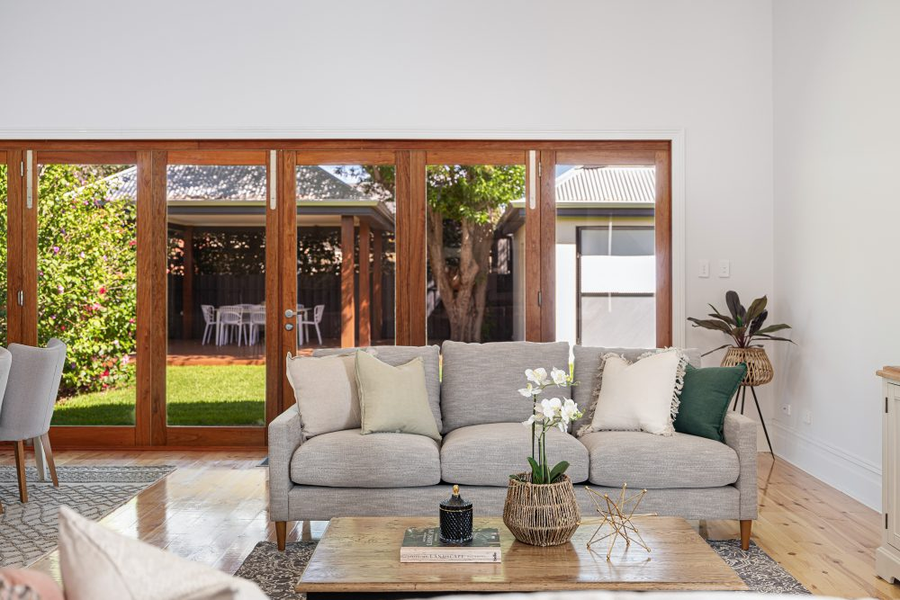 Update Your Period Home Without Losing its Charm bifold doors off living room