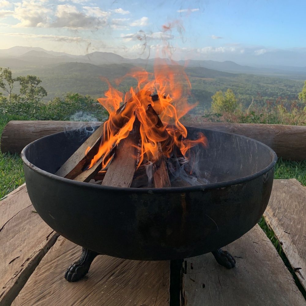 Warm Up Winter With a Fire Pit - fire pit in mountains
