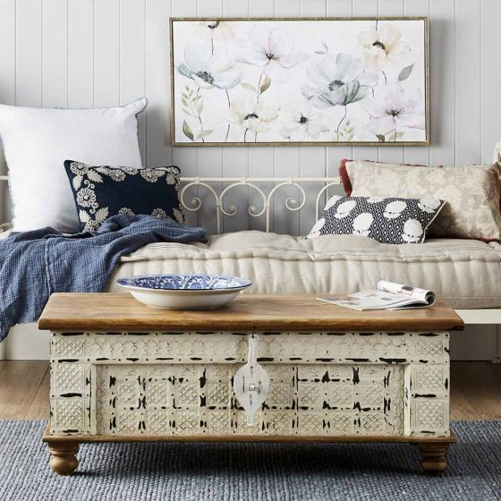 6 Savvy Storage Solutions with a storage trunk coffee table