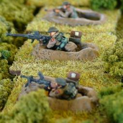 1 Bren gunner in 1 man fox hole firing Bren gun with