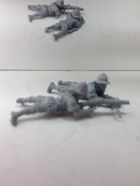 2 British infantry prone firing a Lewis LMG wearing shorts,