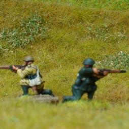 1 x Infantryman firing rifle in kneeling position