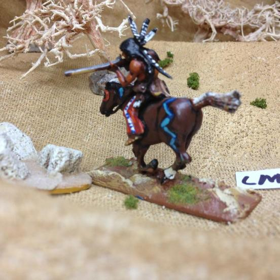 Sioux brave mounted on horse with trade musket.