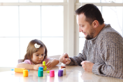 child and dad playing with playdough. sensory play. sense it. EYFS. children's subscription box