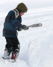boy hitting drift with baseball bat