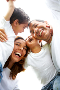 parents and two children hugging