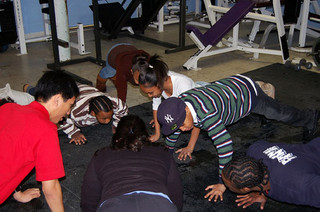 kids in schoolroom doing pushups