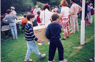 two boys carrying box