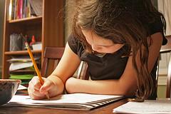 girl working on homework