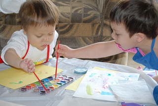 two children painting pictures
