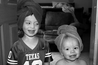 two young boys with towels wrapped around their heads