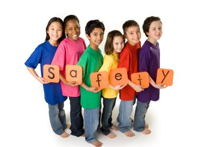 group of children holding signs that spell out safety