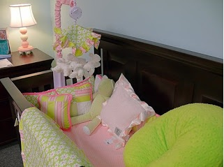 crib with pink and green decorations