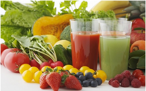two glasses of vegetable and fruit juice, other fruits and vegetables