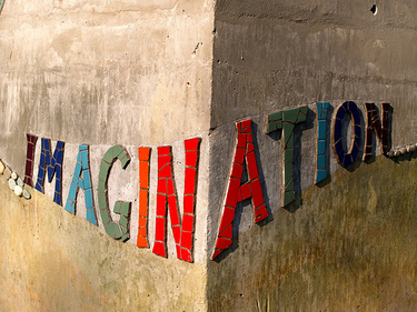 the word imagination on a stone