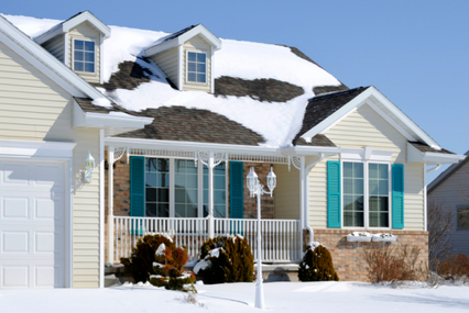 house in winter with snow on roof