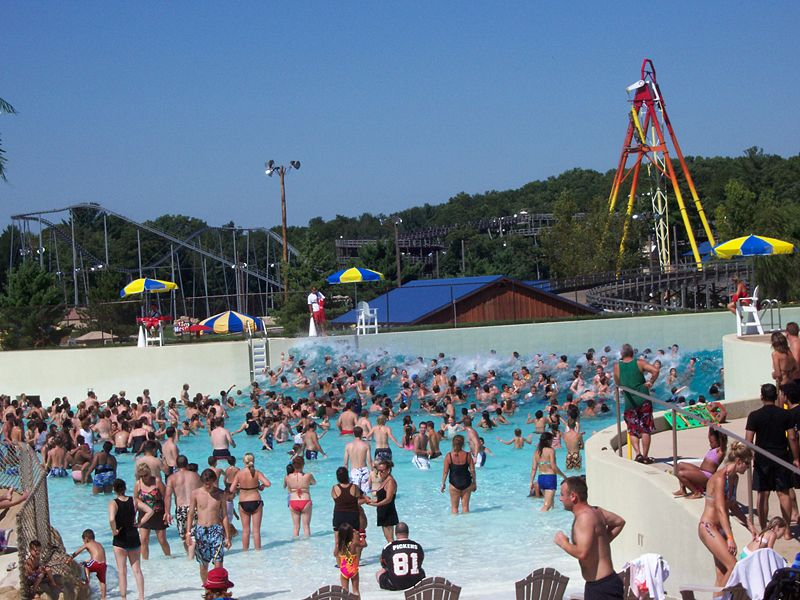 large crowd of people in wave pool at water park
