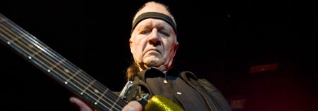 Surf-guitar legend Dick Dale mimics the screams of his lions and tigers