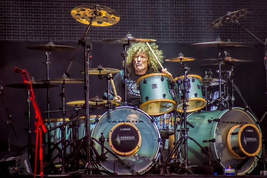 Tommy Aldridge says that doing drum clinics is better than a jab in the ass with a frozen carrot
