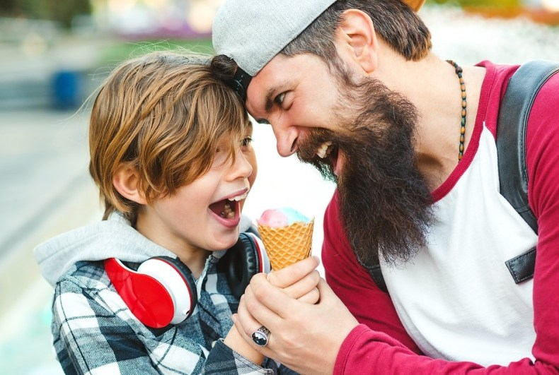 father and son sharing ice cream cone