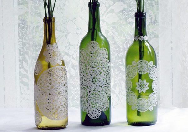 decoupaged doily bottles