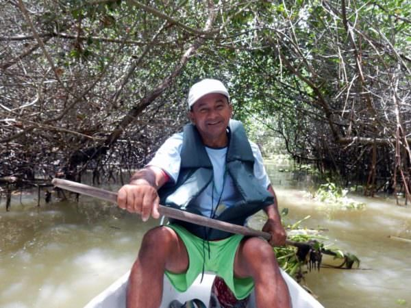 Smiling guide in canoe on Isla Corazon