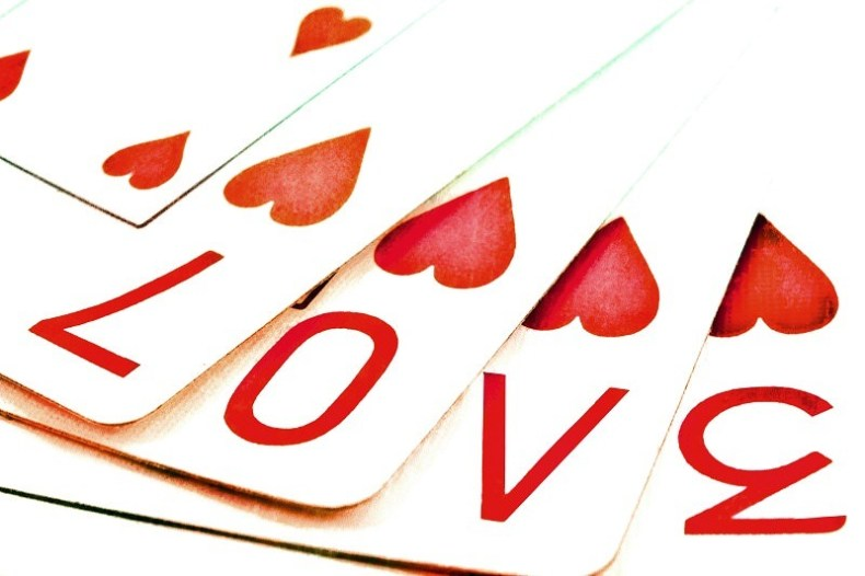 "Playing cards spell out ""LOVE"""