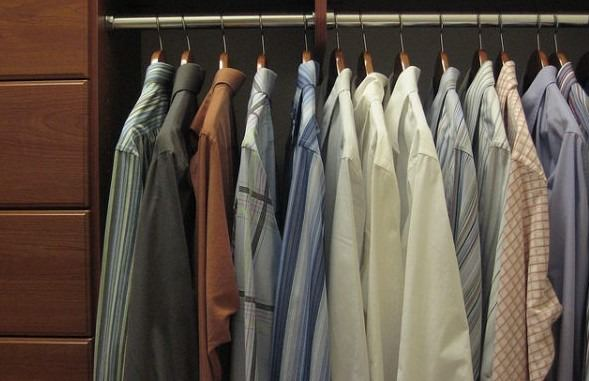 men's dress shirts hanging in closet
