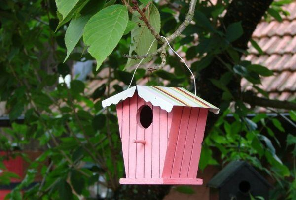 pink birdhouse with striped roof