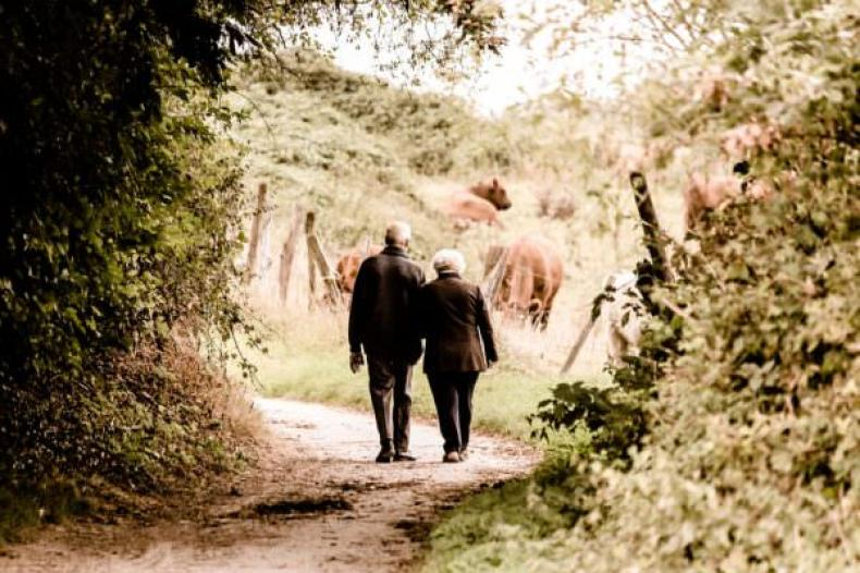 senior couple walking on trail