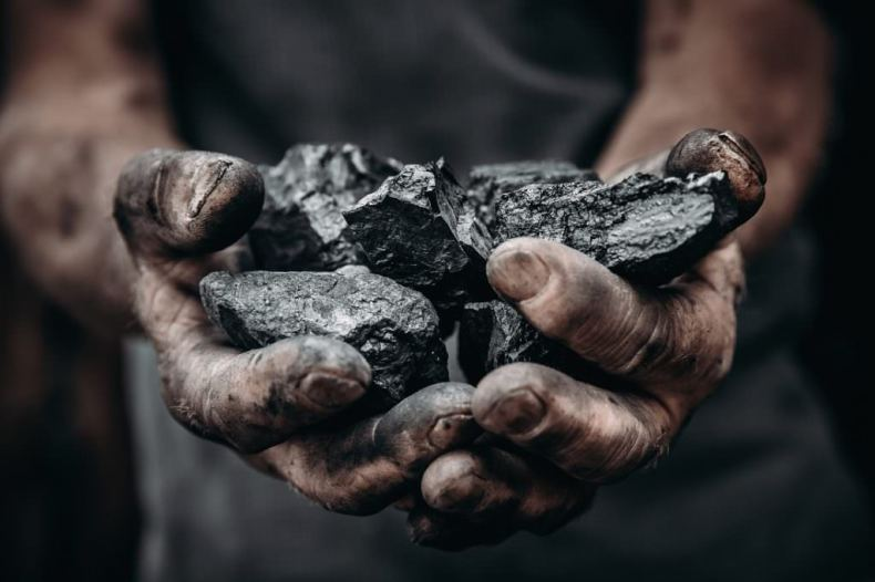 coal in miner's hands