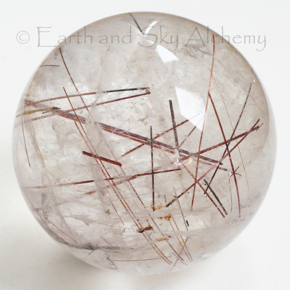 Red rutile quartz sphere