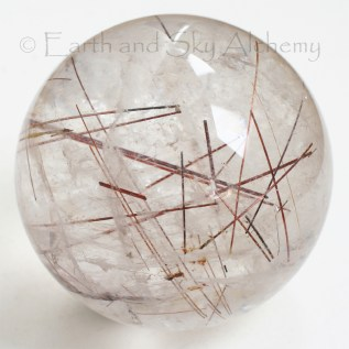 Red rutile quartz sphere