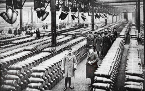 King George V with officials inspecting a British munitions factory, 1917