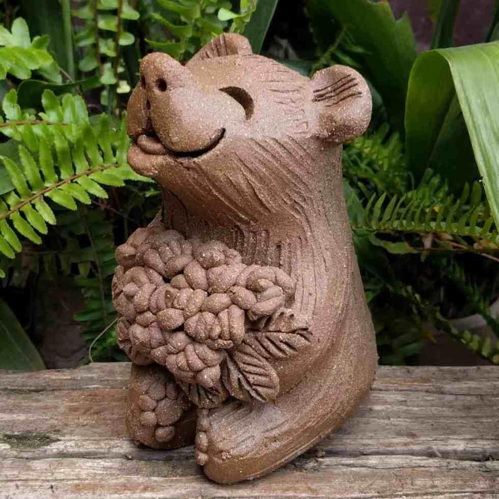sitting_bear_flowers_outside_greenspace_4