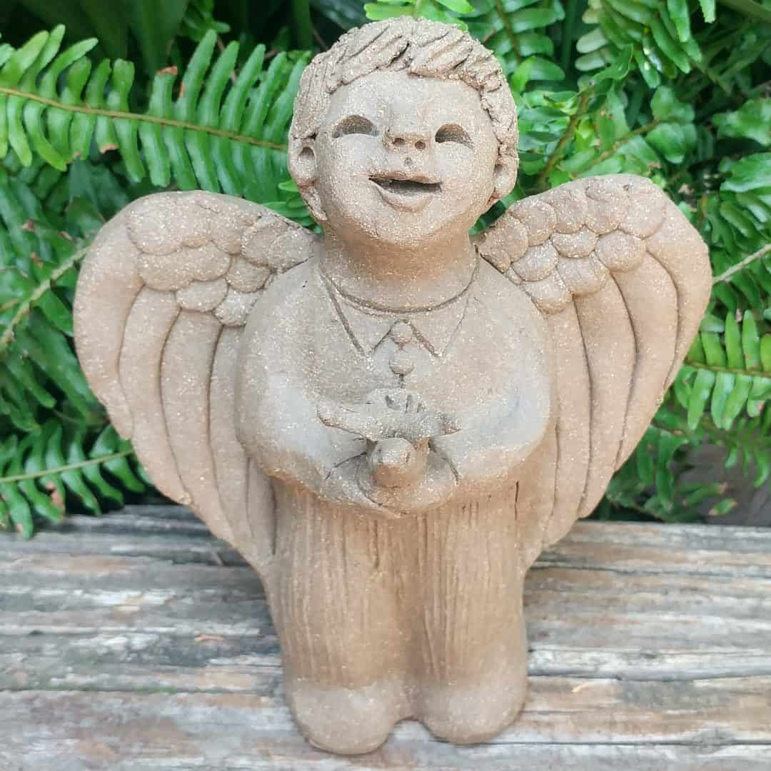 stoneware-angel-boy-holding-bird-small-outdoor-statue-by-margaret-hudson-earth-arts-studio-6