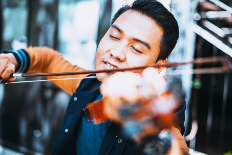 man loves playing violin, closed eyes, joyful